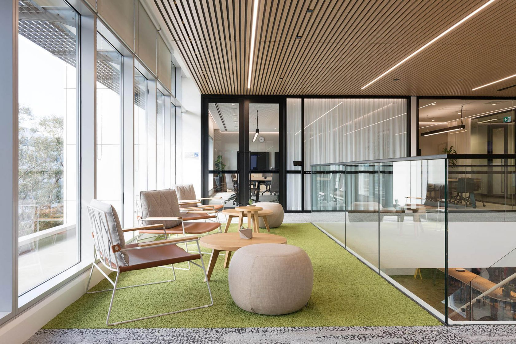 suez office with timber ceiling slats and chairs with foot stool