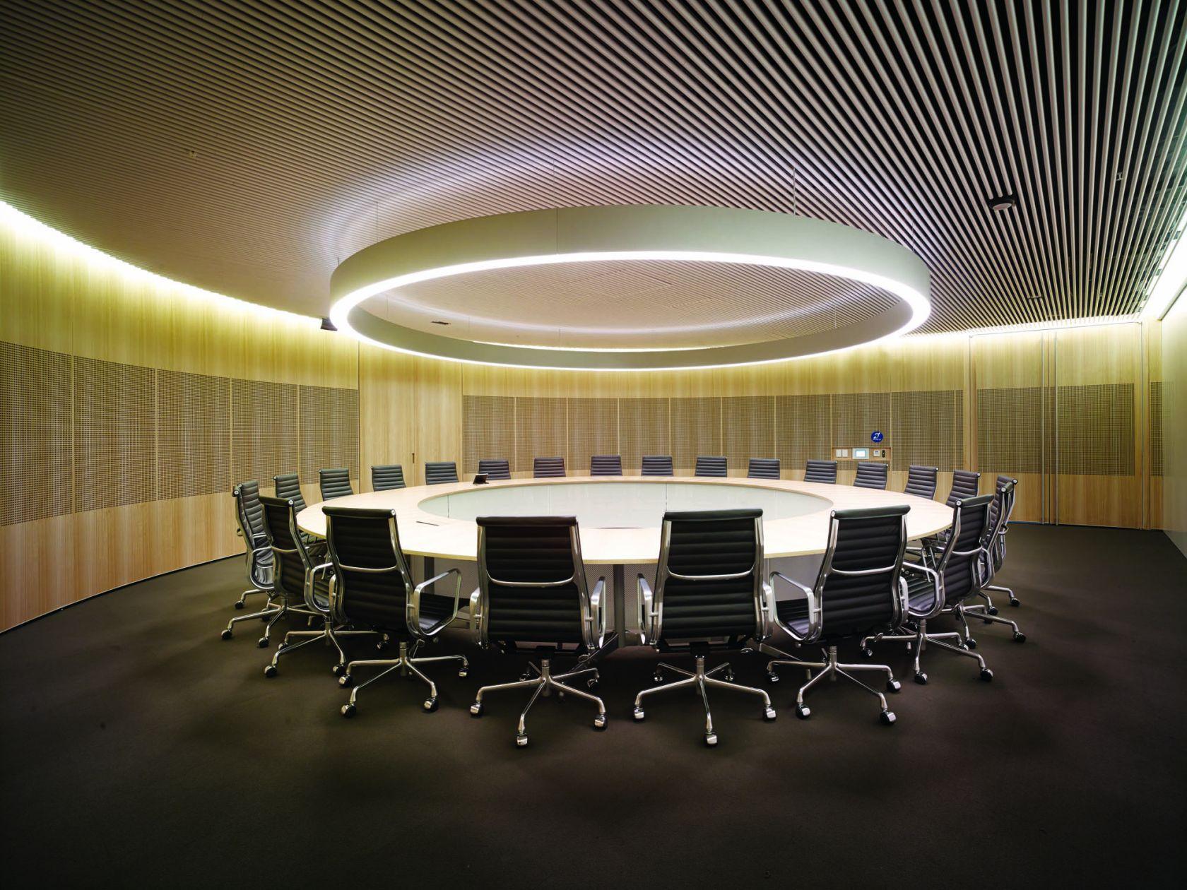 commonwealth parliament office sydney construction fitout boardroom round feature ceiling halo light timber