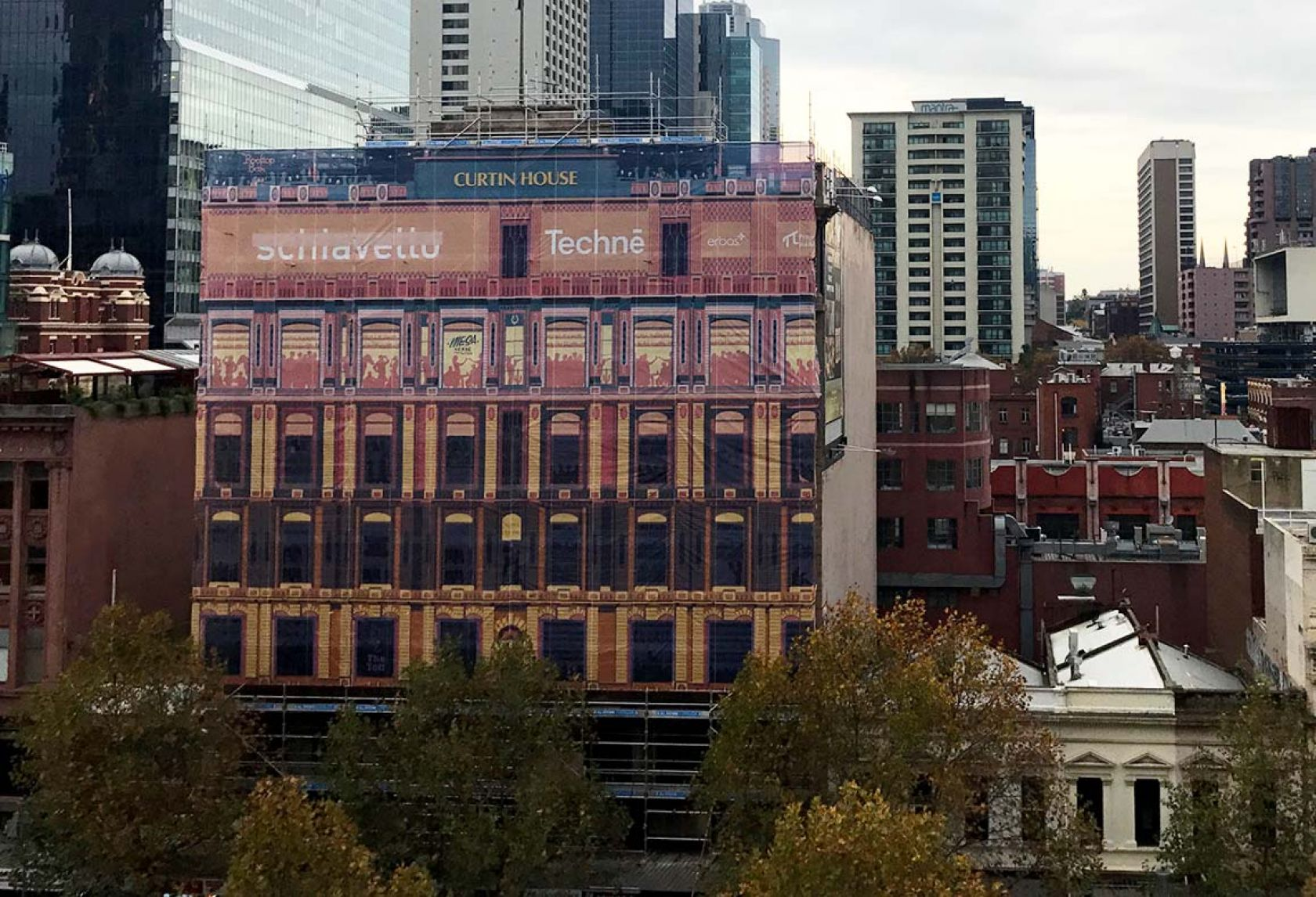 curtin house facade banner on construction site swanston street