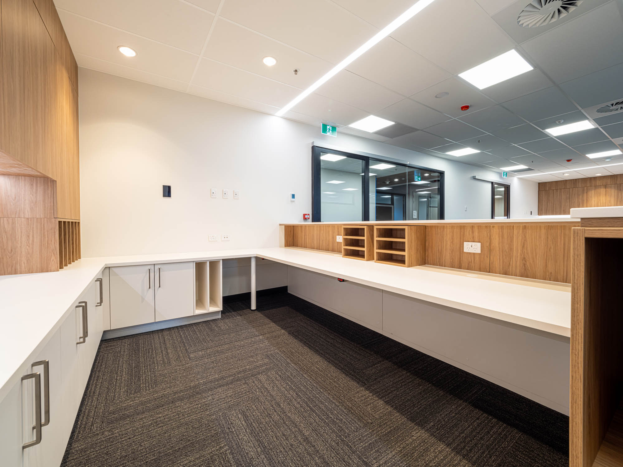 calvary adelaide hospital healthcare aged care fitout construction medical reception desk admission timber linear lighting