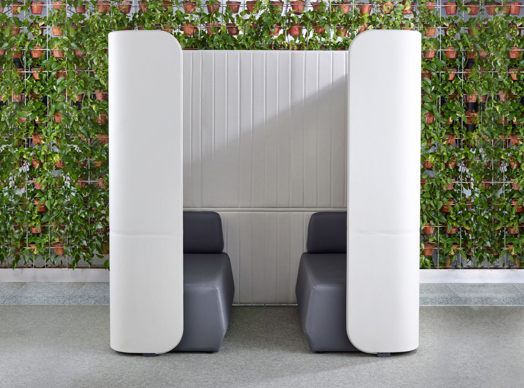 grey focus schiavello furniture booth with vertical garden