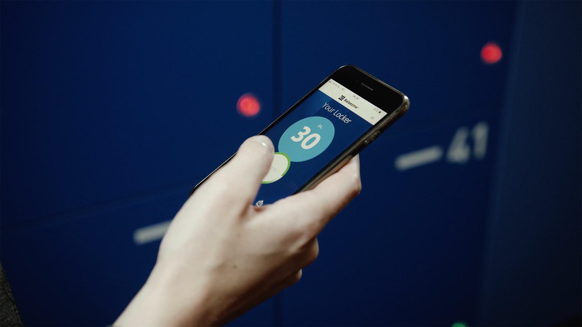 vecos smart locker lady holding smartphone to open storage locker