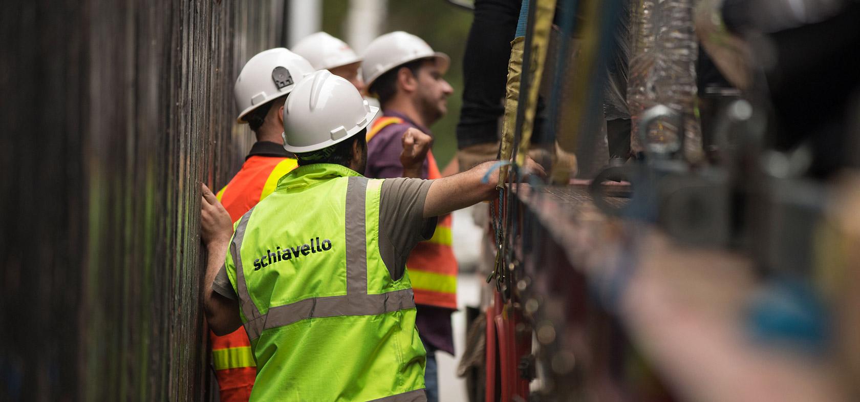 schiavello employees loading truck modular construction