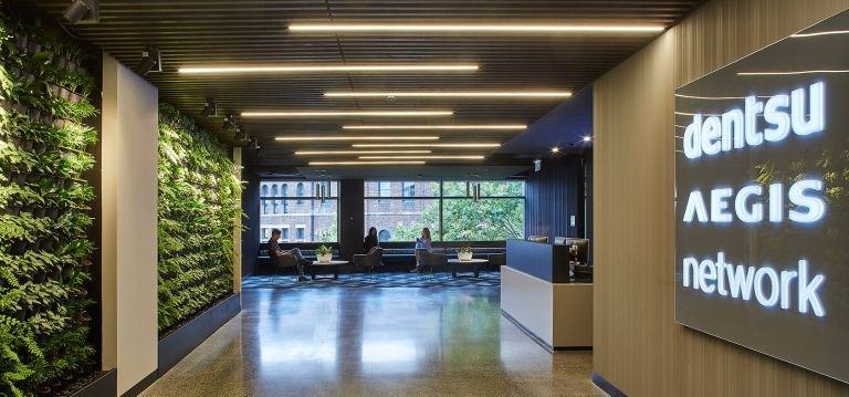 dentsu aegis network reception office fitout green wall