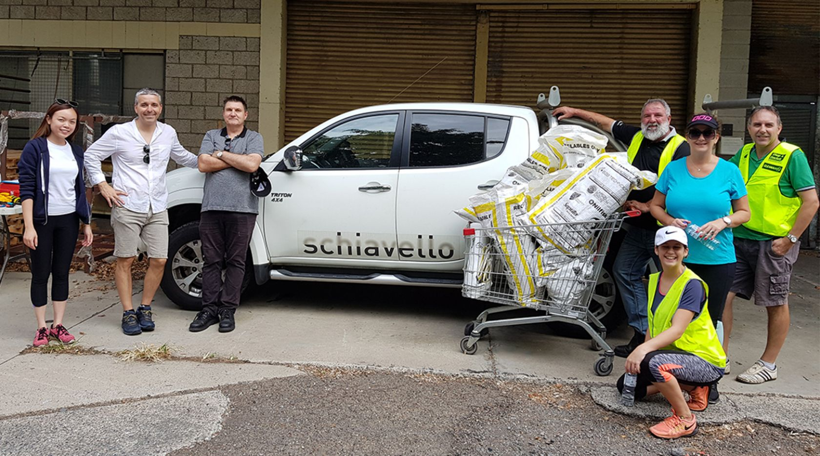 schiavello queensland employees stand in front of white company vehicle for clean up australia day