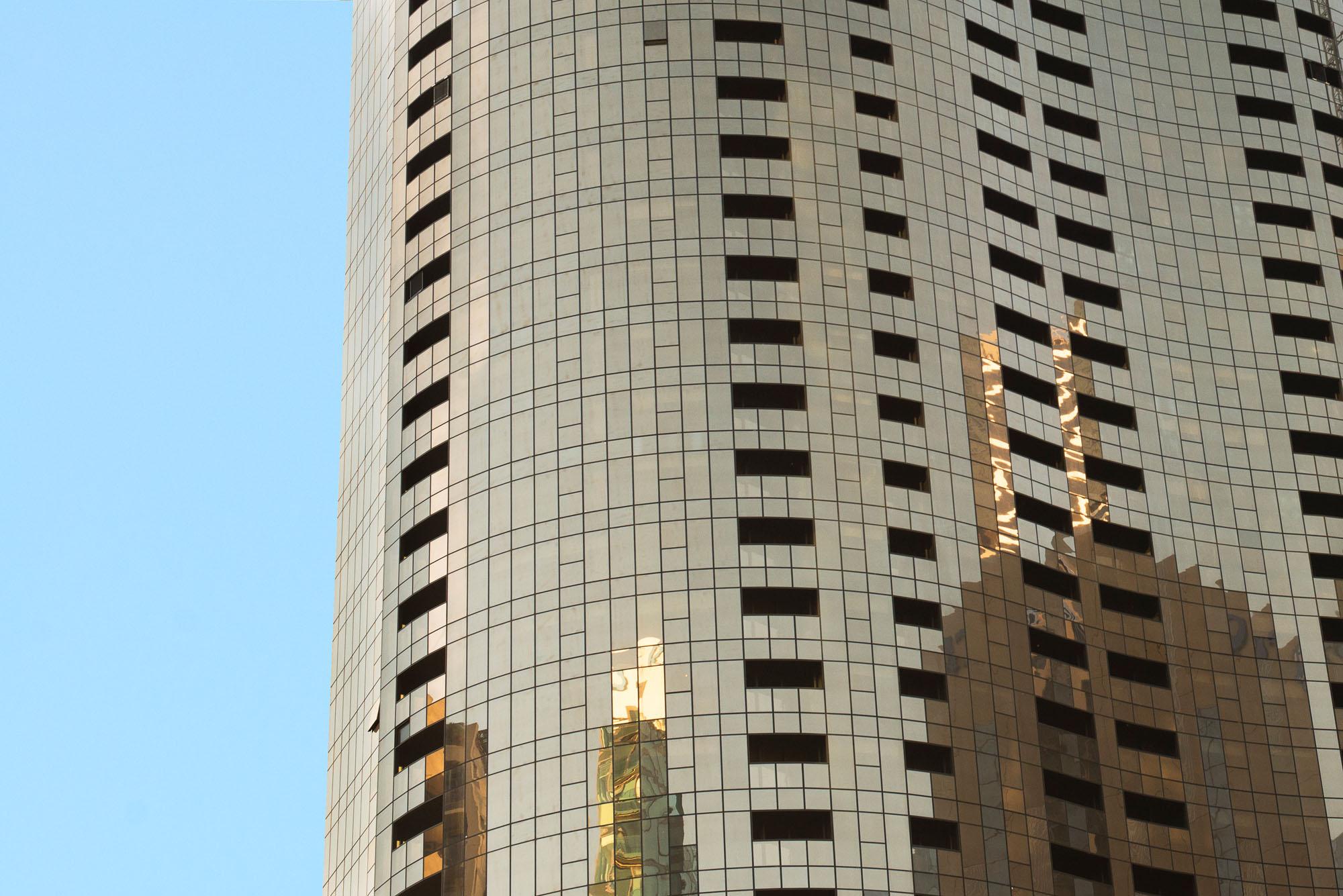 prima tower building exterior facade closeup gold reflection