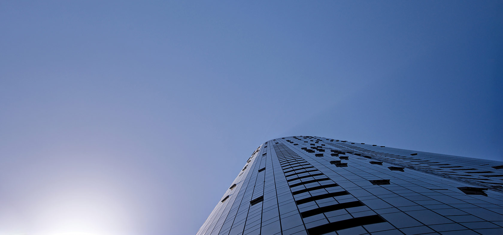 looking up at building in blue sky