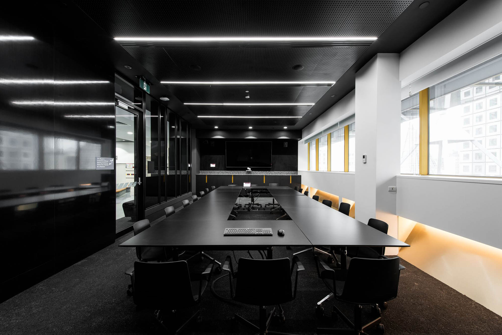 Black boardroom table in RMIT University School of Fashion and Textiles Building