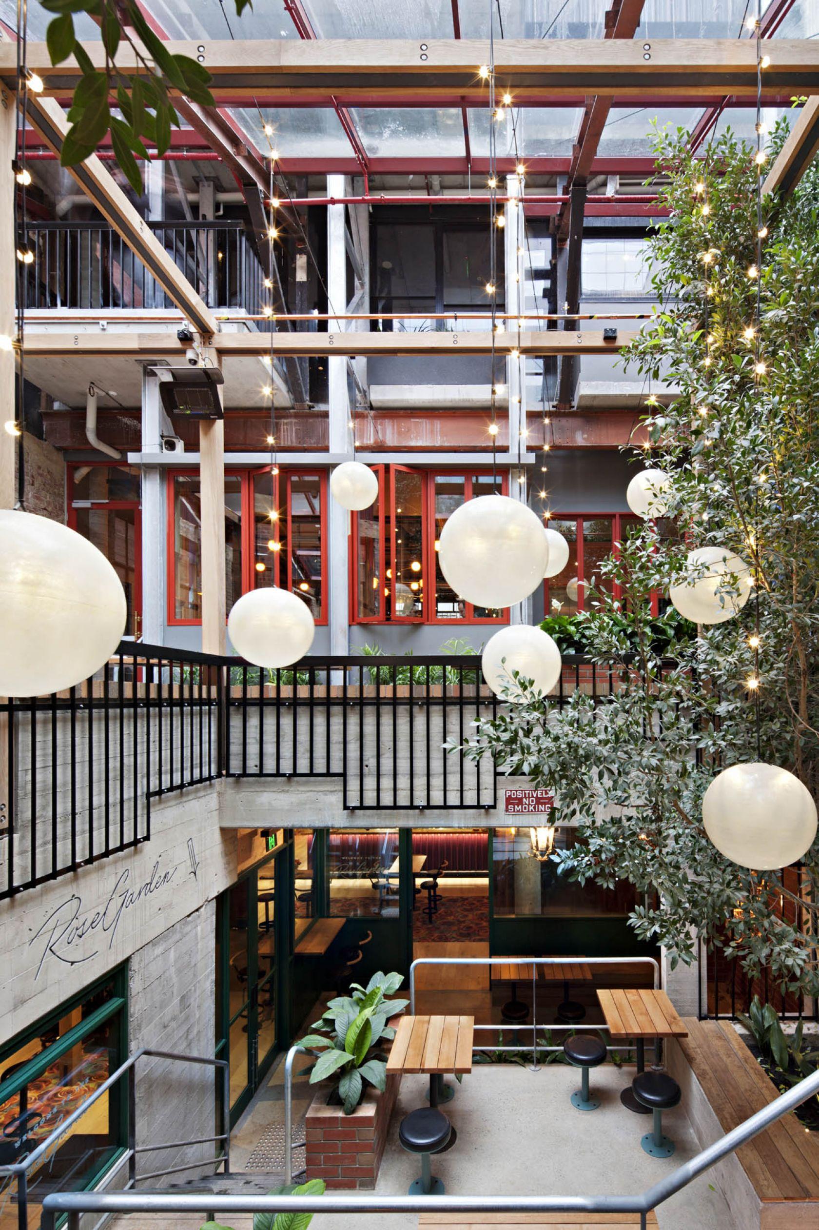 garden state hotel melbourne fitout outdoor alfresco trees pendant lighting balustrades mezzanine