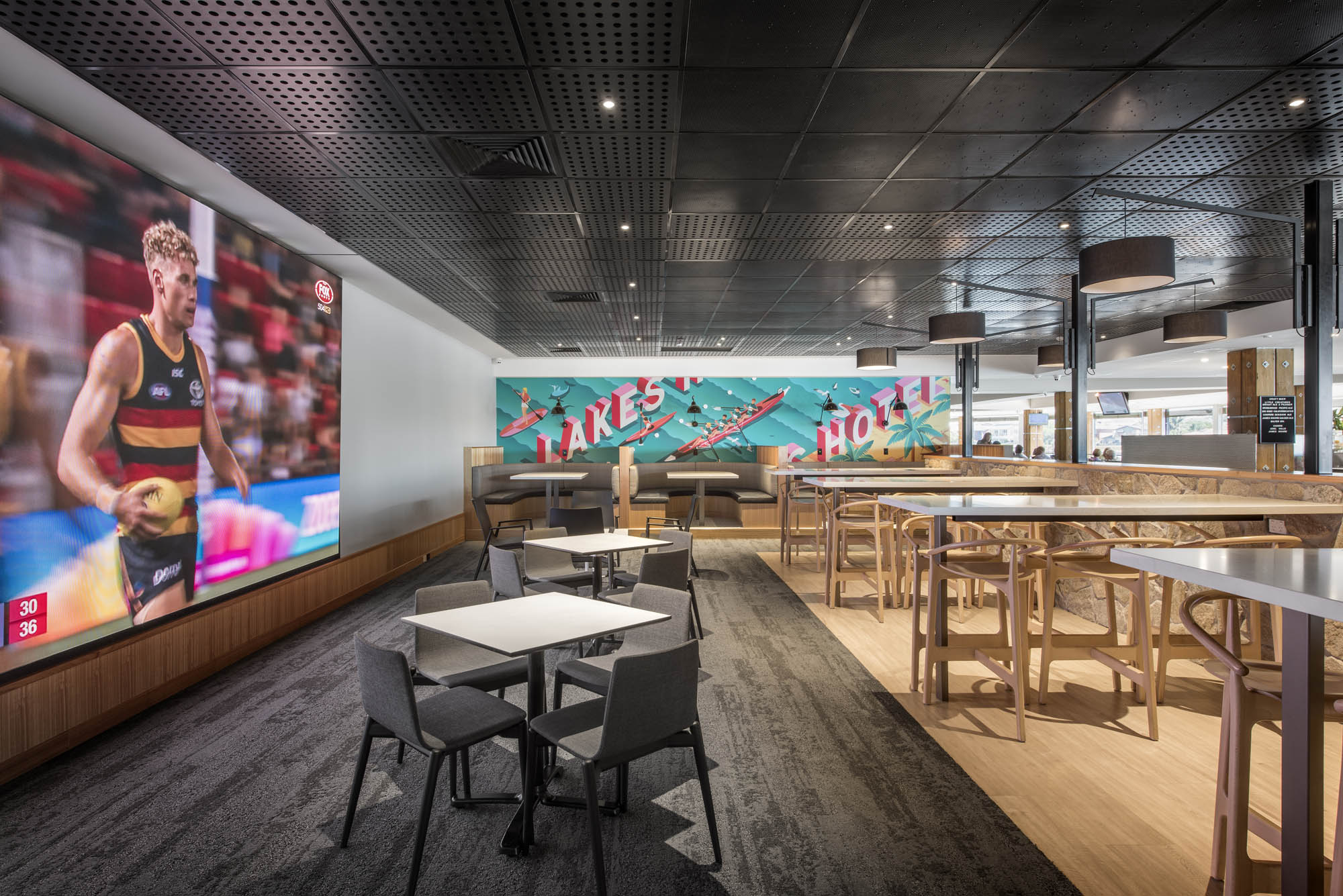 lakes hotel hospitality interior construction sa adelaide west lakes sports bar signage big screen tv afl football food high tables high stools