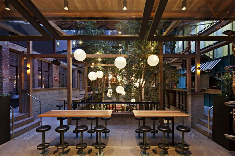 garden state hotel melbourne fitout outdoor bar trees timber lights