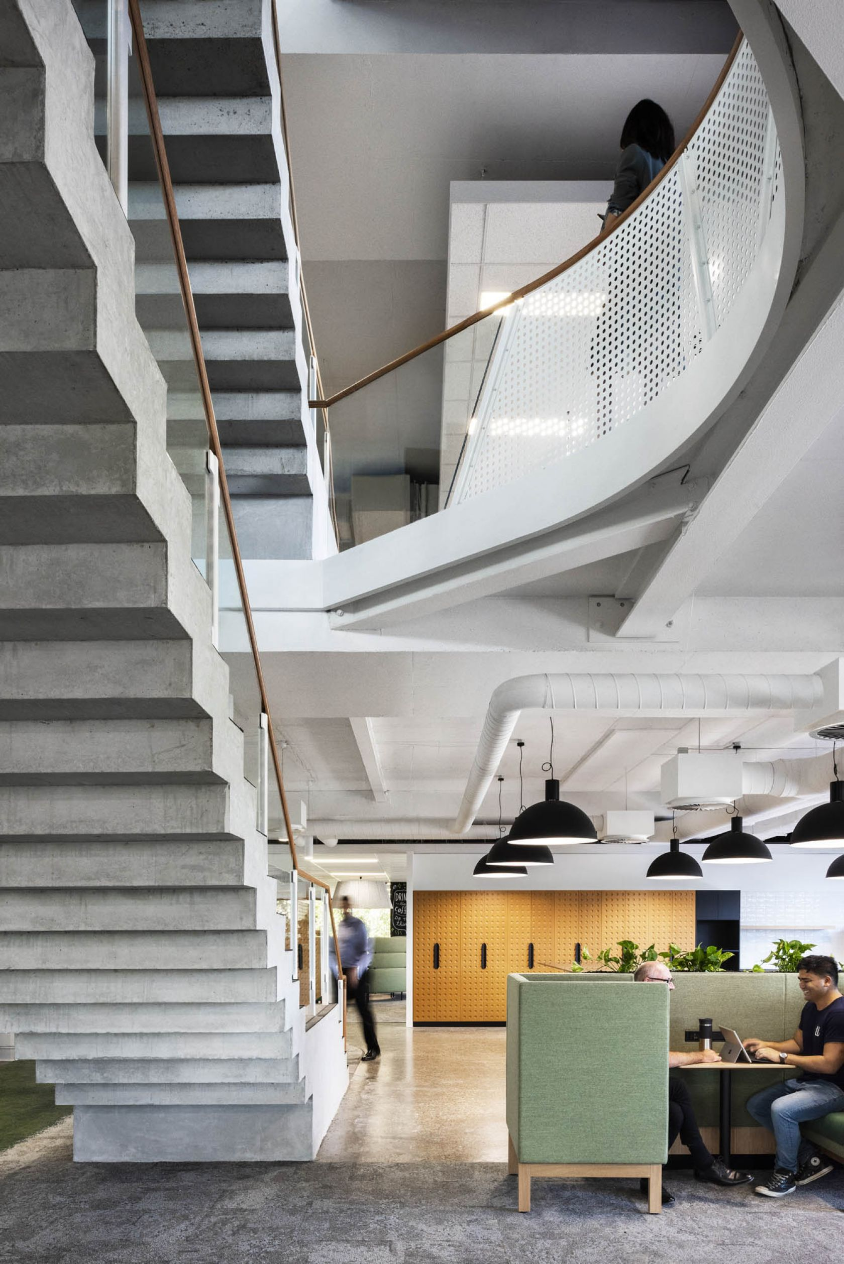 7-Eleven fitout workplace commercial Melbourne stairs concrete glass void