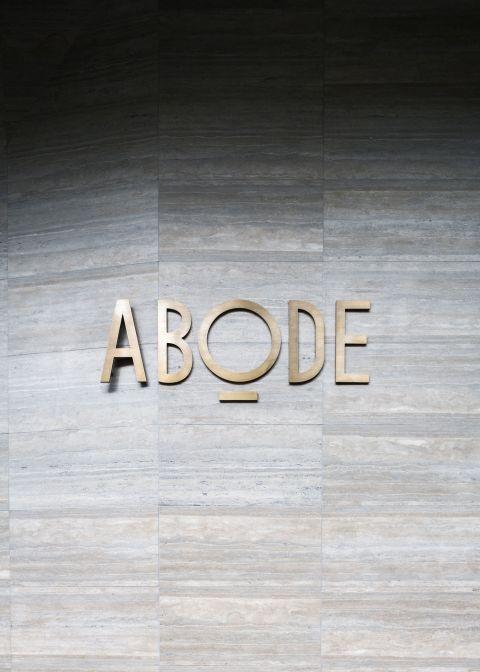 abode318-interior-facade-gold-logo.jpg
