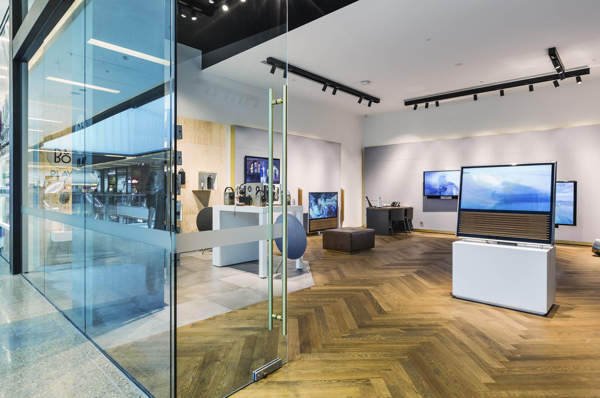 bang and olufsen retail sydney bondi showroom entry doors directional track lighting herringbone floors