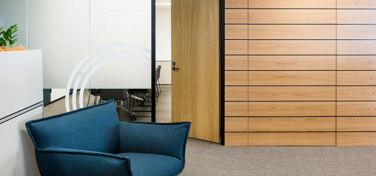 Dark blue single couch and timber wall office meeting room