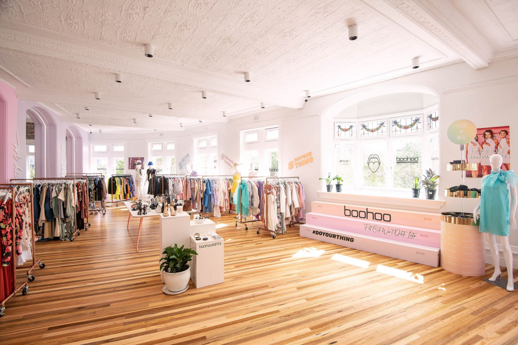 boohoo headquarters sydney darlinghurst schiavello construction heritage fashion garments clothes showroom pressed metal panel ceiilng arches timber floor